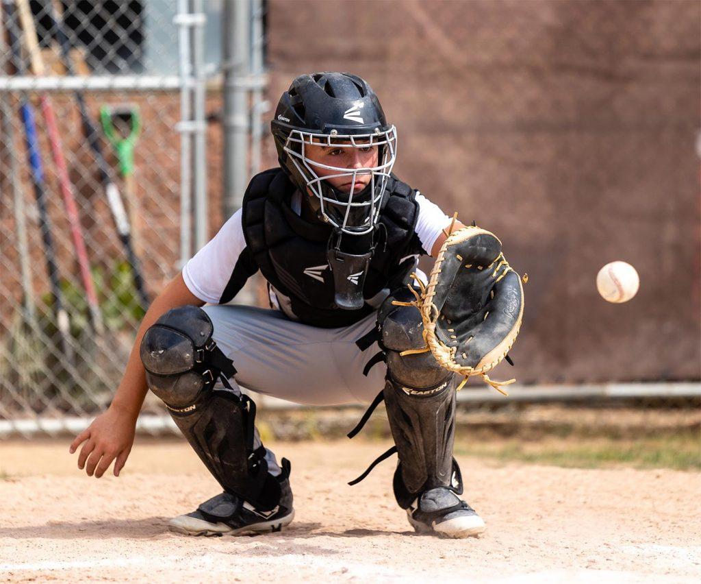 Catcher catching a pitch