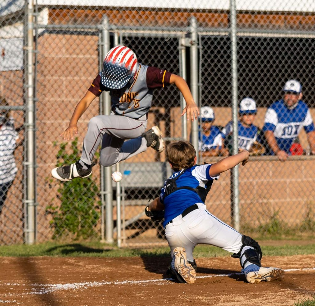 Catcher and runner; play at home base