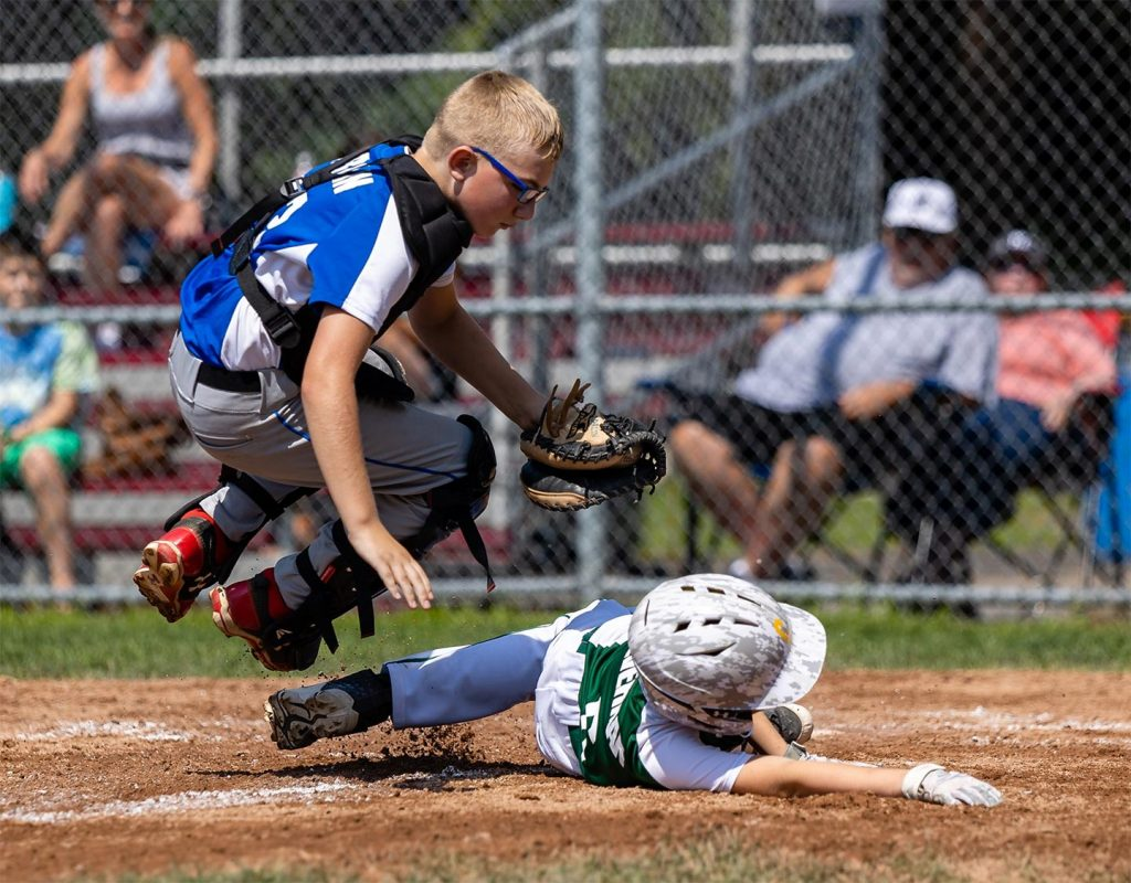 Catcher and runner; jumping play at home base